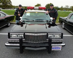 Rod and Michael with the Plymouth Police car that will act as their support vehicle