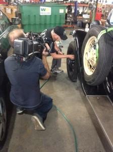 Rod checks the tyre pressue while the cameraman checks on Rod