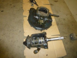The bell housing and gearbox out and on the ground